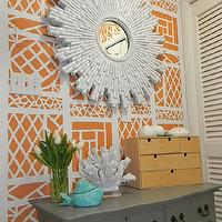 Gorgeous Shiny Things - entrances/foyers - sunburst mirror, white sunburst mirror, orange wallpaper, geometric wallpaper, orange geometric wallpaper, gray chest,