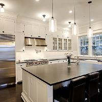 Paul Moon Design - kitchens - white, glass-front, cabinets, honed, black, granite, countertops, espresso, leather counter stools, round, sink, farmhouse, sink, beveled, subway tiles, backsplash, pot filler, oil-rubbed bronze, hardware, Niche Modern Bella Modern Pendant Light, Benjamin Moore Cloud White,