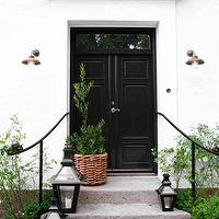 home exteriors - black, doors, black, lanterns,  Birgitta Wolfgang  Gorgeous home exterior with glossy black doors and black lanterns.