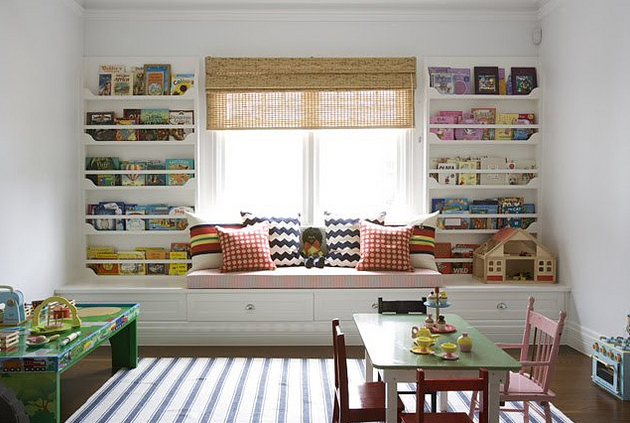 Absolutely Beautiful Things - girl's rooms - playroom, white, blue, striped, ticking, rug, white, blue, zigzag, chevron, herringbone, pillows, red, checkered, pillows, pink, cushion, white, built-in, window seat, bookshelves, roman shade,