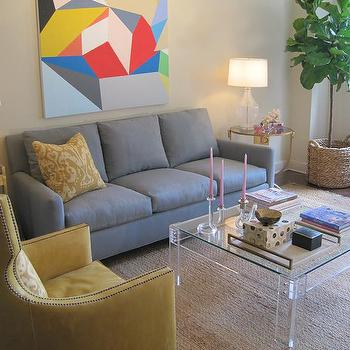 Elizabeth Sullivan Design - living rooms - lucite coffee table, blue sofa, 3 cushion sofa, yellow leather chair, yellow leather chair, yellow leather wingback chair, yellow wingback hair, seagrass rug, art over sofa,