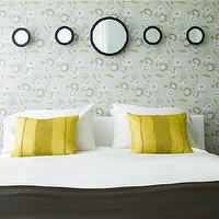 Carlos Miranda Design - bedrooms - bourgie lamps, bourgie table lamps, yellow pillows, charcoal gray blanket, wallpaper headboard, bed with no headboard, ghost lamps, ghost table lamps,
