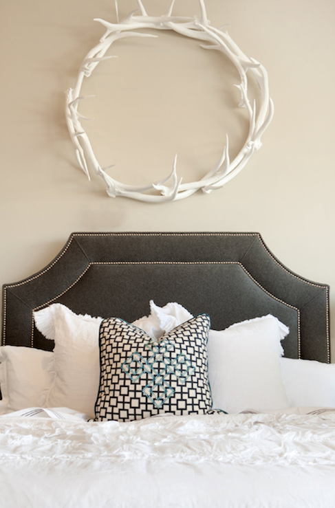 Ashlee Raubach Photography - bedrooms - Oly Studio Antler Wreath, charcoal, gray, velvet, headboard, nailhead trim, white, ruffled, bedding, white, black, Cat&#039;s cradle, fabric, pillow, tan, walls, gray velvet headboard, velvet headboard, gray headboard,