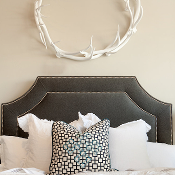 Ashlee Raubach Photography - bedrooms - velvet headboard, gray velvet headboard, dark gray headboard, ruffle bedding, white ruffle bedding, ruffle duvet, white ruffle duvet, ruffle shams, white ruffle shams, zebra pillows, antler wreath, Oly Studio Antler Wreath,