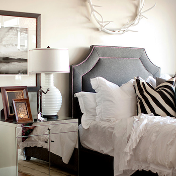 Ashlee Raubach Photography - bedrooms - wall decor, mirror nightstand, mirrored nightstands, velvet headboard, gray velvet headboard, dark gray headboard, ruffled bedding, white ruffled bedding, ruffled duvet, white ruffled duvet, ruffled shams, white ruffled shams, zebra pillows, antler wreath, Oly Studio Antler Wreath, Oly Studio Eva Bedside Table,