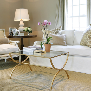 Ashley Goforth Design - living rooms - brass coffee table, glass and brass coffee table, french coffee table, french brass coffee table, white sofa, leopard pillow leopard print pillow, Oly Studio Hanna Chair,