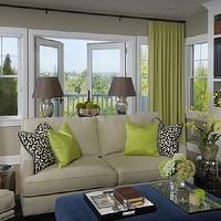 Graciela Rutkowski Interiors - living rooms - green, silk, drapes, French doors, gray, walls, tan, sofa, chairs, green, blue, pillows, blue, square, velvet, ottoman, silver, garden stool, white, built-ins, TV,