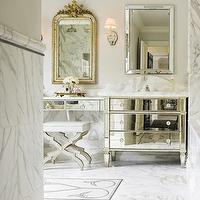 bathrooms - mirrored vanity, mirrored bathroom vanity,  Carrie Hayden  Marble bathroom with mirrored sink and vanity top.