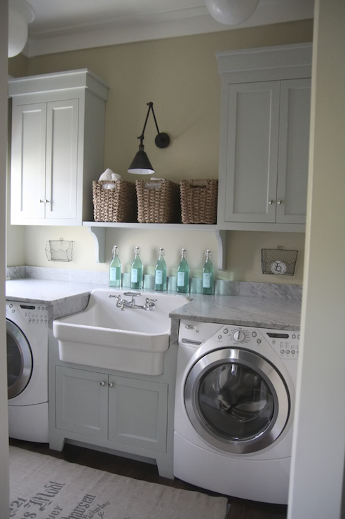 Urban Grace Interiors - laundry/mud rooms - green, gray, walls, woven, baskets, white, shaker, cabinets, white, washer, dryer, farmhouse, sink, white, carrara, marble, countertops, burlap, sack, rug,