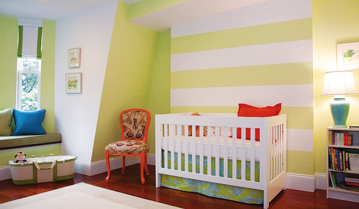 nurseries - gender neutral white yellow striped walls white modern crib blue green crib bedding orange pillow orange accent chair built-in window seat white roman shades green ribbon trim