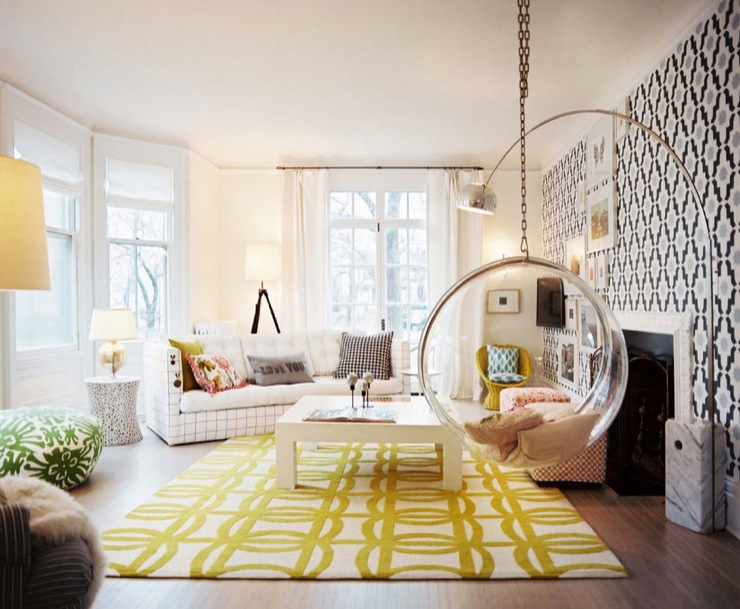 Lonny Magazine - living rooms - bubble chair, hanging bubble chair, bubble hanging chair, yellow rug, white and yellow rug,  modern living room