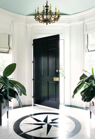 entrances/foyers - turquoise blue painted ceiling glossy black front door brass accents marble tiles floor black compass design ivory roman shades gray ribbon trim chandelier