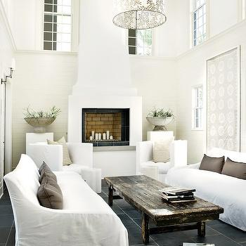 Atlanta Homes & Lifestyles - living rooms - story living room, 2 story room, two story living room, white slipcovered sofas, slate floor, slate tiles, slate tiled floor,