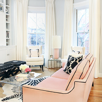 Erin Gates Design - living rooms - gray, walls, pink, sofa, black, piping, white, black, Thomas Paul, flock, pillows, layered, rugs, zebra, cowhide, rug, jute, rug, monogrammed, black, x-bench, white, piping, white, wingback, chairs, pink, lamp, pink, zigzag, chevron, pillow, CB2 Peekaboo Clear Coffee Table,