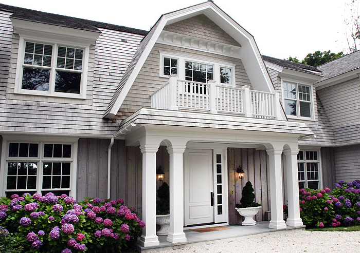 home exteriors - white columns gray siding pink purple hydrangeas  Elsa Soyars  Beautiful home exterior with crisp white columns, second story
