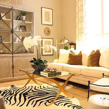M. E. Beck Design - living rooms - zebra rug, seagrass rug, white sofa, chinese garden stool, vintage garden prints, white orchid, gray wall paint, brass coffee table, x brass coffee table, glass front cabinet, x coffee table, x base coffee table, mirrored top coffee table,