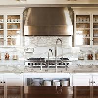 Alice Lane Home - kitchens - moroccan tile wallpaper, moorish tile wallpaper, back of cabinets lined with wallpaper, back of kitchen cabinets lined with wallpaper, white marble backsplash, marble slab backsplash, double kitchen faucets, glass front kitchen cabinets,