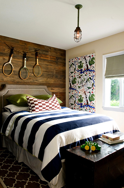 boy's rooms - navy blue moorish tiles wool rug khaki linen headboard nailhead trim rustic wood paneled wall white blue striped bedding yellow walls
