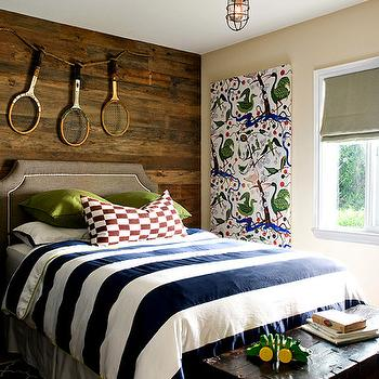 Adorable boy's bedroom design with rustic wood paneled walls, butter yellow walls ...