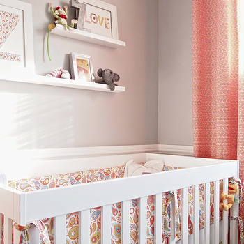 Cape 27 - nurseries - pink drapes, pink curtains, pink window panels, white crib, light gray walls, pink and gray nursery, shelves over crib, shelves above crib, shelving over crib, shelving above crib,