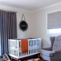 Jute interior Design - nurseries - gray and orange nursery, gray curtains, gray drapes, modern crib, orange throw, orange throw blanket, gray glider, gray tufted glider, striped rug, white and orange striped rug,