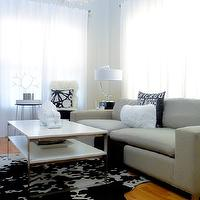 Desert Domicile - living rooms - coffee table, white coffee table, tiered coffee table, cowhide rug, black and white cowhide rug, gray sofa, modern gray sofa,