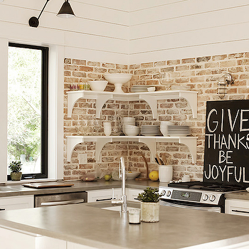 Urban Grace Interiors - kitchens - grey countertops, gray countertops, kitchen with exposed brick wall, exposed brick wall, exposed brick wall in kitchen, paneled kitchen, white cabinets with gray countertops, white kitchen cabinets with gray countertops, kitchen shelving,