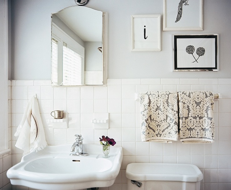 bathrooms - white gray damask hand towels vintage white pedestal sink white porcelain tiles backsplash gray walls  Angie Hranowsky  Lonny Mag