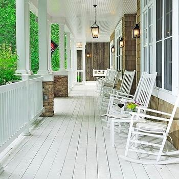 porches - rocking chairs, plank floors, black lanterns, white plank floors, whitewashed floor, white painted floor, beadboard ceiling, covered porch, whitewashed floor,