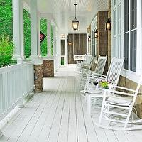porches - white, rocking chairs, white, washed, plank floors, black, lanterns,  pinterest  Gorgeous porch with white washed wood plank floors,