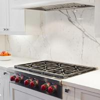 BiglarKinyan Design - kitchens - crisp, white, kitchen cabinets, calcutta, marble, counter tops, backspalsh, brushed nickel, square, modern, hardware, warming drawers,