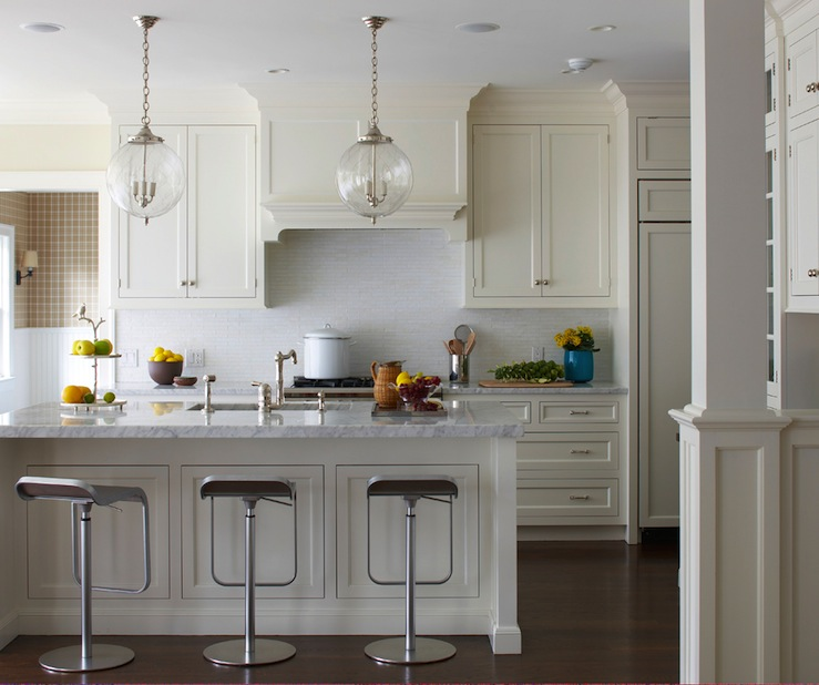 Muse Interiors - kitchens - piston bar stools, ivory cabinets, ivory shaker cabinets, ivory shaker kitchen cabinets, piston bar stools, piston counter stools, paneled refrigerator, globe pendants,