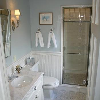 Graciela Rutkowski Interiors - bathrooms - chrome and glass shower door, white and blue bathroom, beadboard bathroom, beadboard backsplash, rectangular pivot mirror, marble mosaic tile, marble mosaic tile floor, marble mosaic tiled bathroom floor, marble mosaic tile bathroom,