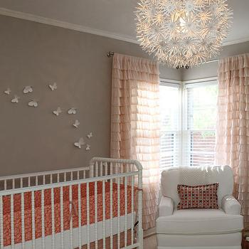 Apartment Therapy - nurseries - ruffle drapes, pink drapes, pink curtains, ruffled curtains, pink ruffled drapes, pink ruffled curtains, gray walls, pink and gray nursery, ikea chandelier, white crib, jenny lind crib, Urban Outfitters Waterfall Ruffle Curtains, Ikea PS MASKROS,