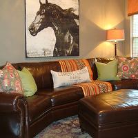 living rooms: sofa, lamps, rug, valance,  Family/TV Room   brown leather couch with nailhead trim, brown/gray or gray/brown wall color with pops
