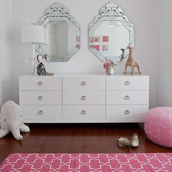 Sissy and Marley - girl's rooms: moroccan rug, moroccan tile rug, pink moroccan rug, pink moroccan tile rug, moorish tiles rug, pink moorish tile rug, ring pulls, pink trellis rugs, trellis rugs, pink pouf, pink leather pouf, pink moroccan pouf, pink moroccan leather pouf, white lacquer dresser, venetian mirror, chic girls room, girls bedroom,