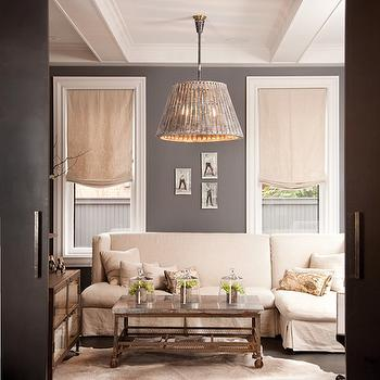 Capital Style - living rooms - slipcovered sectional. slipcovered sofa, linen slipcovered sectional, gray walls, dark gray walls, white cowhide rug, linen roman shades, industrial coffee table,
