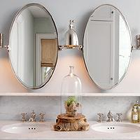 Capital Style - bathrooms - oval pivot mirrors, glass terrarium,  Master bathroom design with oval pivot mirrors, polished nickel sconces, marble
