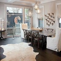 Capital Style - dining rooms - cowhide rug, white cowhide rug, slipcovered captain chairs, captain dining chairs, french cafe dining chairs, rectangular dining table,