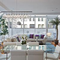 Marie Burgos Design - living rooms - Loft, penthouse, Tribeca, marie Burgos, glass dining table, blue rug, white leather chair, wood floors, artwork, art, modern design, blue pillow, lavender pillow, lavender, blue, white, glass, metal,