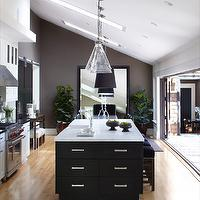 Urrutia Design - kitchens - Kitchen Family, Great Room, Nana Doors, Nana, Pendant, Chrome Pulls, Chrome Knobs, Black Shaker Cabinets, White Shaker Cabinets, Island, Oak Floor, Flooring, White Marble, Black Granite, White Carrera, Skylight, Multiple Skylights, Vaulted Ceiling, Modern Urban Farm House Kitchen, Open Kitchen, Large Kitchen, Kitchen Family Room, Contemporary Kitchen, Modern Kitchen, Ranch Style, Kitchen Cabinets, Ranch House, Ranch Home, California Ranch, Contemporary Kitchen, Traditional Kitchen, Kitchen, rolling door, wall mounted door, contemporary door, black door, black doors, Ballard Designs Pendant,