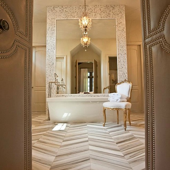 Dodson and Daughter Interior Design - bathrooms - marble floors, marble tile floor, herringbone tiles, herringbone tile floor, herringbone marble tiles, herringbone marble floor, marble herringbone tiles, marble herringbone floor, marble herringbone tile floor, marble herringbone tile bathroom, bathroom with bi fold doors, gray doors, gray bi fold doors, soaking tub, bathroom floor mirror,