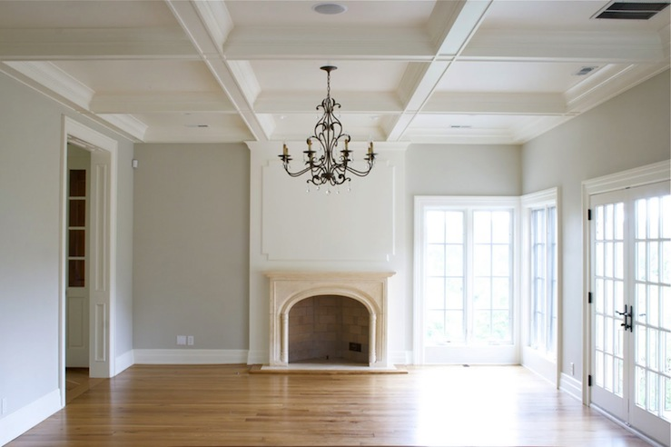 Tiek Built Homes - living rooms - gray, walls, coffered ceiling, limestone, fireplace, French doors, decorative, wall panels, oak, wood floors,