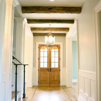 Tiek Built Homes - entrances/foyers - foyer wainscoting, wainscoting, wainscoting in foyer, herringbone floor, rustic wood beams,  Beautiful