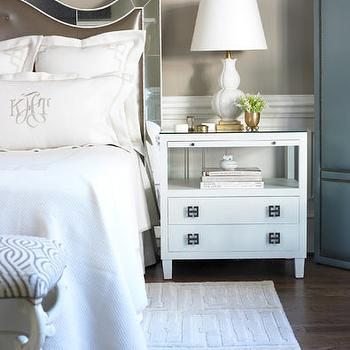 Courtney Hill Interiors - bedrooms - mirror headboard, mirrored headboard, monogrammed bedding, white nightstands, geometric hardware,  Chic