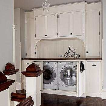 Jessica Helgerson Interior Design - laundry/mud rooms: hidden washer and dryer, second floor laundry room, second floor washer and dryer,  Chic