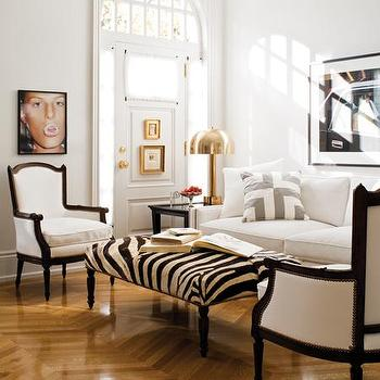 House & Home - living rooms - zebra bench, zebra ottoman, herringbone floor, herringbone wood floor,  Chic city living room design with wood