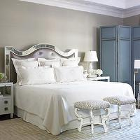 Courtney Hill Interiors - bedrooms - mirror headboard, mirrored headboard, monogrammed bedding, white nightstands, geometric hardware, mirrored bed, purple tufted headboard, floor screen, blue floor screen, folding screen, blue folding screen, french stools, french ottomans,