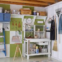 Martha Stewart - garages - blue, green yellow, dot, painted, floors, white, work station, white, green, utility, wall, peg boards,  Fun, colorful