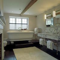 Carden Cunietti - bathrooms - wood beam, square, beveled, mirror, marble, double washstands, porcelain tub, gray, walls, stainless steel, towel warmer, ebony, matte, hardwood, floors,
